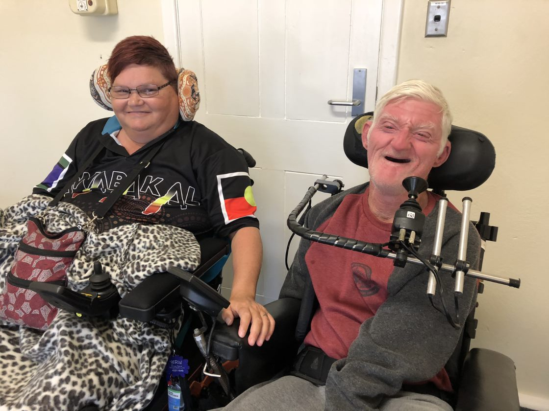 Two people with disabilities