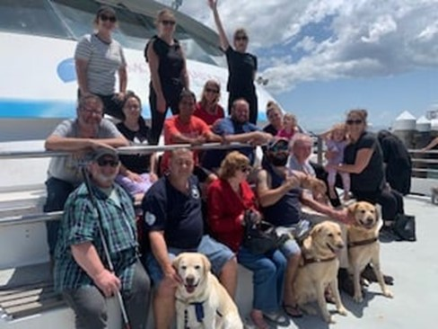 The Deafblind Group smiling on a Boat